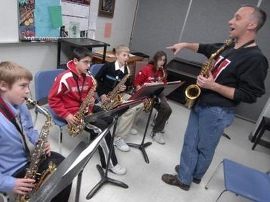 John Greiner, shown here teaching a saxophone class at the Wausau Conservatory of Music, will perform at Una Notte Bella with his Little Swingshift Band.