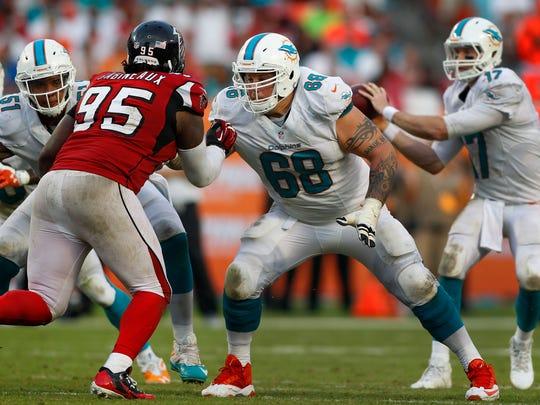 Miami Dolphins guard Richie Incognito (68) blocks Atlanta