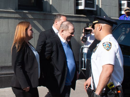 Harvey Weinstein leaves the New York City Police Department's