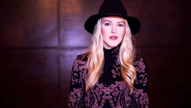 """Country music artist Ashley Campbell performs """"Winter Wonderland"""" with her bluegrass band at Big Machine Label Group's headquarters in Nashville on Wednesday Dec. 9, 2015. This is part of The Tennessean's Country Christmas songs 4-part series."""