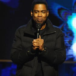 """Chris Rock performs on stage at Comedy Central's """"Night of Too Many Stars: America Comes Together For Autism Programs"""" on February 28 in New York City."""