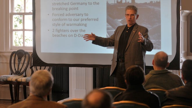 Dr. Mark Conversino, out-going dean at Air War College, speaks at Maxwell Air Force Base on Feb. 20. Conversino taught a history lesson on American pilots during a commemoration of the Big Week airstrike during WWII.