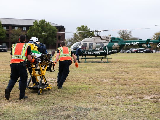 """A San Angelo Fire Department team moves a """"victim"""" to Shannon AirMed1 during an active shooter exercise Thursday at Goodfellow Air Force Base."""