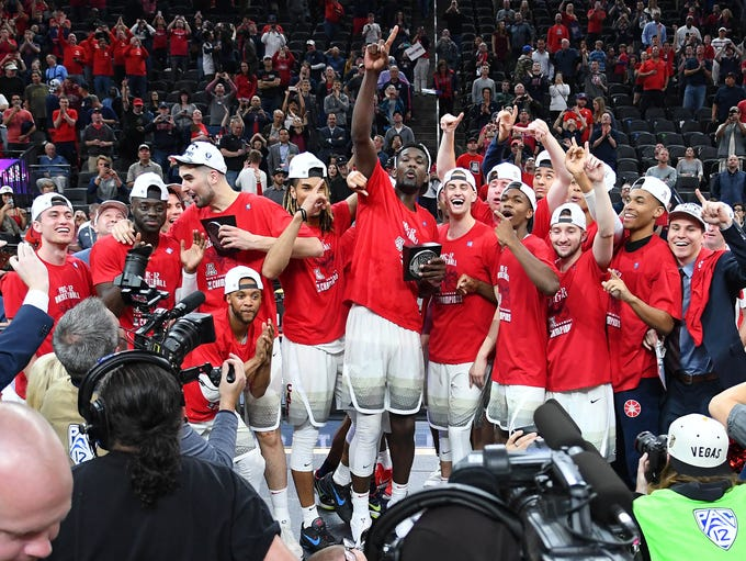The Arizona Wildcats celebrate after defeating the