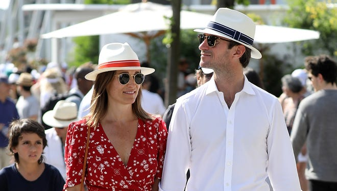 Pippa Middleton, with husband James Matthews, wears a graphic wrap dress perfect for summer.