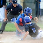 Licking Valley third baseman Austin Skeese tags out Bexley's Tate Hughes during a Division II district semifinal Tuesday at Worthington Kilbourne.