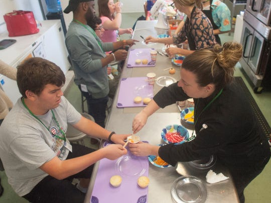 Chef, Katie Sklarow, right, and SMASH program student, Mac Banquier, make cupcakes at the Moorestown Recreation Center. The SMASH program stands for Social Meeting After School Hours. Students rotate through different stations to interact with teachers and volunteers.