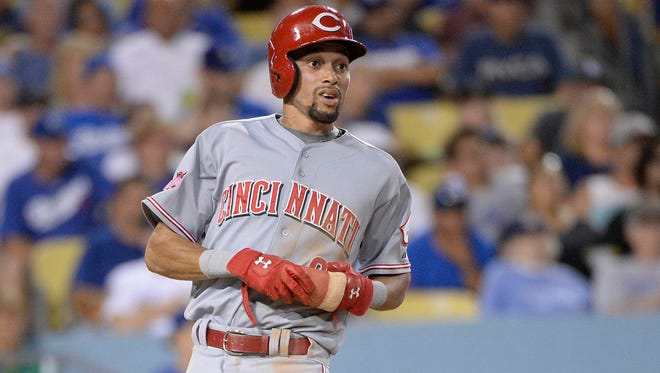 Cincinnati Reds center fielder Billy Hamilton (6) reacts after scoring a run in the fifth inning against the Los Angeles Dodgers at Dodger Stadium.