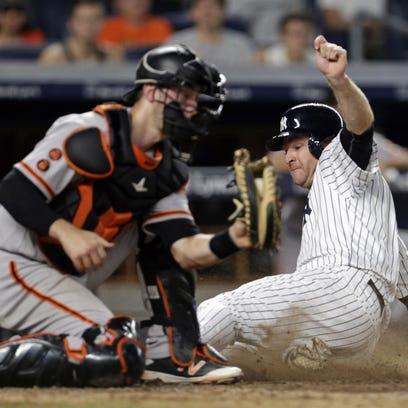 New York Yankees third baseman Chase Headley scores