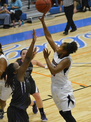Louisiana College's Neka Jones goes over two against Concordia's Isis Johnson on Thursday night.