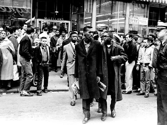 Black demonstrators, including John Lewis, center in light suit, are hustled out of McLellan's Variety Store on Fifth Avenue North in downtown Nashville and off to jail after a four-hour demonstration against lunch counter segregation Feb. 27, 1960.