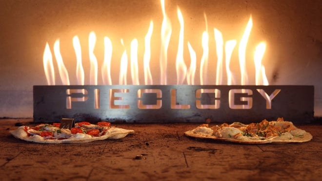 Pizzas bake in the large oven at Pieology Pizza in Rancho Mirage