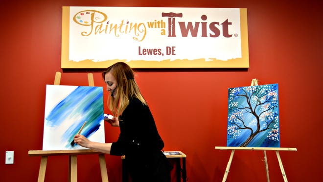 Katie Champagne leads the grand opening class at Painting with a Twist in Lewes, April 6. Painting with a Twist will participate in Rehoboth Beach's Beach Goes Blue event in June.