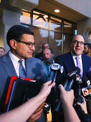 Arizona Coyotes Attorney Nicholas Wood, left and President Anthony LeBlanc speak of legal action against the city of Glendale after the council voted to back out of their agreement with the NHL team during a special council meeting Wednesday, June 10, 2015 in Glendale, Ariz.