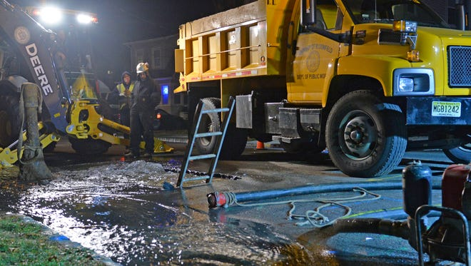 Bloomfield Public Works crew members tend to a 6-inch water main break on Maolis Ave., at the intersection of Thomas Street Monday evening. Dec. 12, 2016.