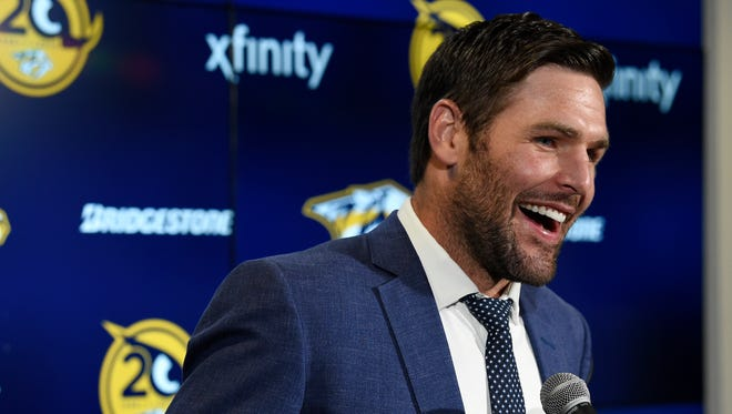 Former Predators captain Mike Fisher speaks to the media between the first and second periods of the home opener Oct. 10, 2017, at Bridgestone Arena.