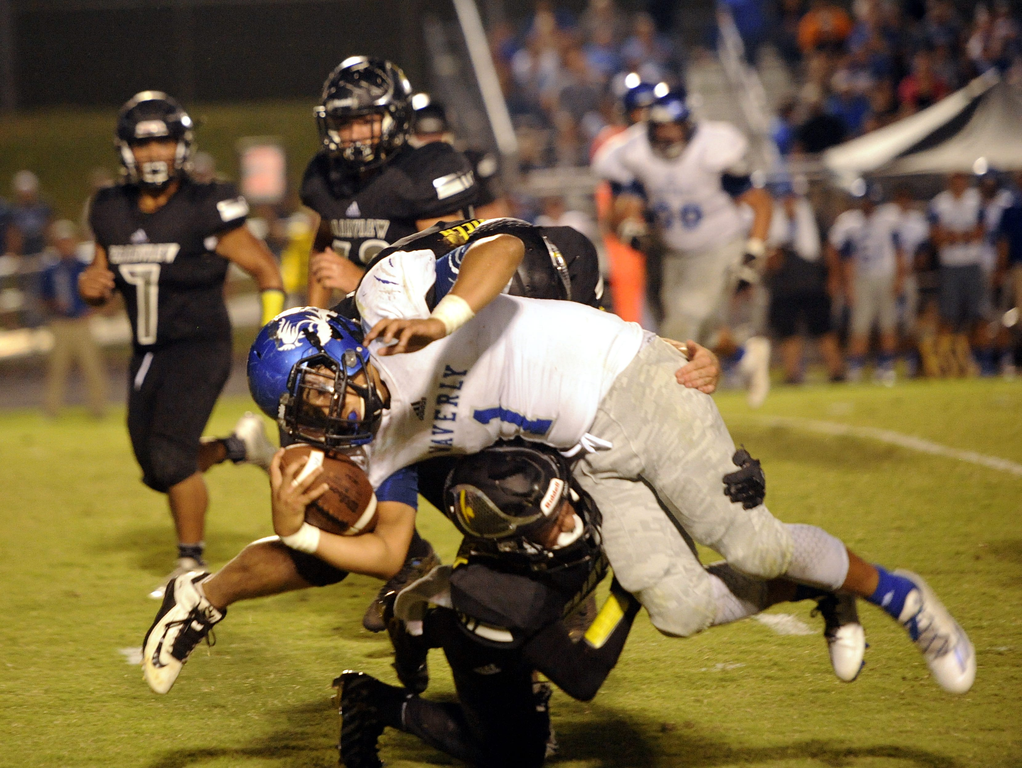 Waverly junior running back Michael Jackson is upended by Fairview junior Khristain Harris-Lusk.