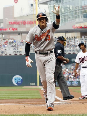 Baltimore Orioles' Manny Machado celebrates his solo home run off Minnesota Twins pitcher Phil Hughes in the first inning of a baseball game, Monday, July 6, 2015, in Minneapolis.