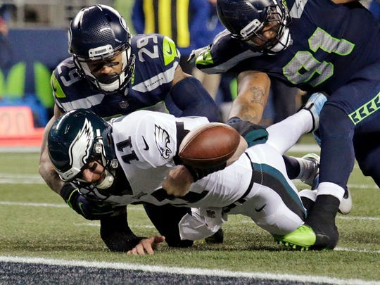 Seahawks safety Earl Thomas forces a fumble by Eagles quarterback Carson Wentz during a December game in Seattle. Despite Thomas's continued excellent play, his age and attitude could make him expendable this offseason, John McGrath writes.