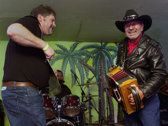 Zydeco legend Willis Prudhomme, right, performs at