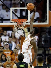 Texas forward Mohamed Bamba (4) scores against Baylor during the first half of an NCAA college basketball game, Monday, Feb. 12, 2018, in Austin, Texas. (AP Photo/Eric Gay)