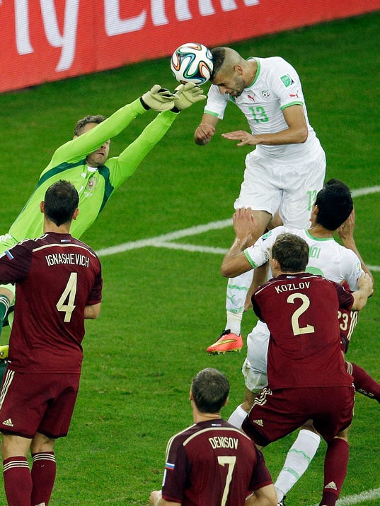 Algeria's Islam Slimani scores his side's first goal during the group H World Cup soccer match between Algeria and Russia at the Arena da Baixada in Curitiba, Brazil, Thursday, June 26, 2014. (AP Photo/Michael Sohn)