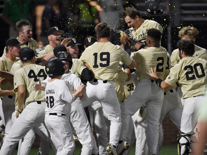 Vanderbilt right fielder JJ Bleday (51) is congratulated
