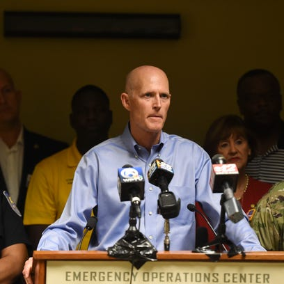 """Surrounded by local St. Lucie County leaders, Gov. Scott delivered a press conference to warn Florida residents to take the threat of Hurricane Matthew seriously on Wednesday, Oct. 5, 2016 at the St. Lucie County Emergency Operations Center in Fort Pierce. Gov. Scott said Hurricane Matthew is a """"potentially catastrophic storm"""" and encouraged residents to have a 3 day supply of water and food. """"Do not take any chances and do not wait,"""" Gov. Scott said.  """"We can rebuild a home, we can rebuild a business, we cannot rebuild your life."""" He is expected to fly into Martin County today."""