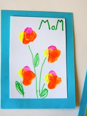 Overlapping thumbprints make a pretty bouquet of flowers.