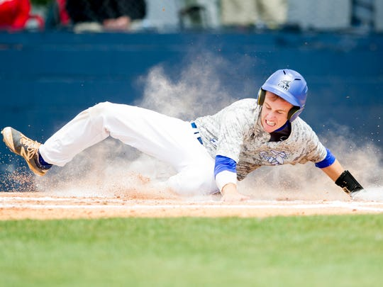Lexington's Evan Gilliam (4) slides home during a Division 1 Class AA baseball game between CAK and Lexington at the 2017 TSSAA Spring Fling state championships at Blackman High School in Murfreesboro, Tennessee on Thursday, May 25, 2017.