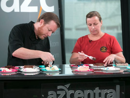Chef Justin Beckett (L) and Tracy Dempsey (R) taste