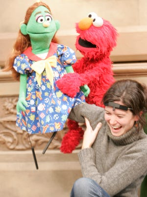 USA TODAY's Olivia Barker tried her hand at puppeteering on 'Sesame Street' in 2004.