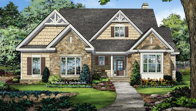 Stone and shingle siding join with decorative trusses and an eye-catching metal awning for tremendous curb appeal.