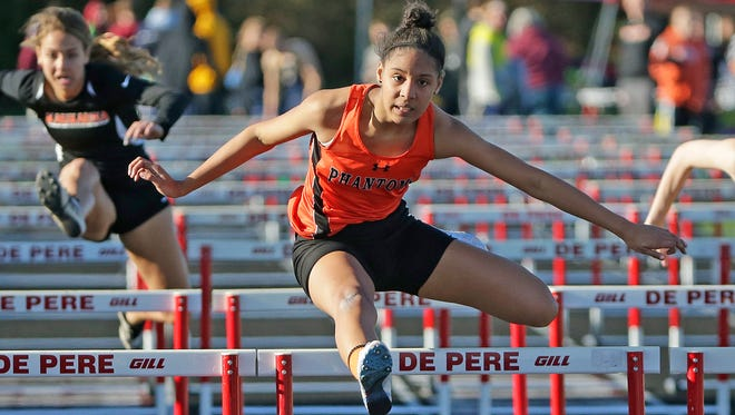Pejha Mitchell of West De Pere runs the 100-meter hurdles at the Dan Baker Track and Field Invitational at De Pere High School on Friday.
