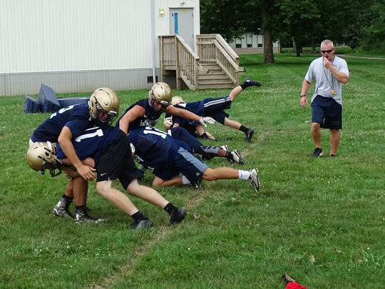 Lancaster defensive coordinator Andy Knuckles looks on as members of the Lancaster football team go through tackling drills during the first day of practice in 2016. Knuckles is leaving the program to become the assistant principal at Lancaster High School.