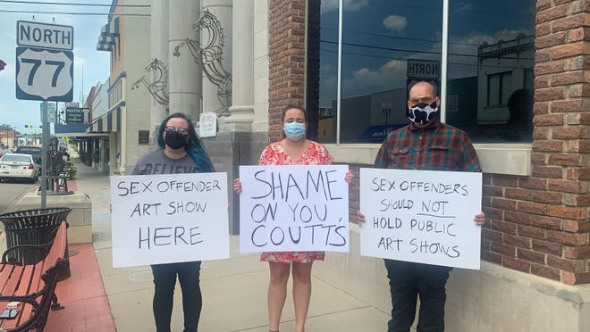 Lana Malone, left, and friends protest outside of Coutts Museum of Art.