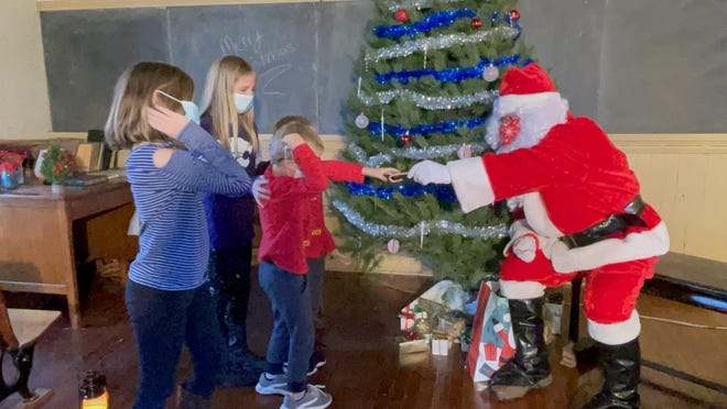 Santa handed out candy canes to all the boys and girls during Santa at Boom Town.