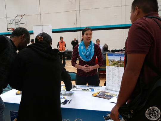 Fort Lewis College admissions councilor Jenna Gilbert talks with students on Wednesday during a college and career activity that was part of International Week festivities at Navajo Preparatory School in Farmington.