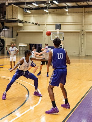 Members of the Western Illinois basketball team go through a drill during practice earlier this fall.