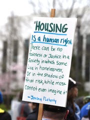 Homeless advocates and the homeless themselves rally on the steps of the Capitol today to bring awareness to the plight of the homeless. on Wednesday, March 11, 2015, at the Oregon State Capitol in Salem.