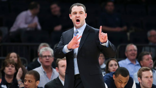 Butler head coach Brandon Miller directs his players from the bench during the first half of an NCAA men's college basketball game against Seton Hall in the first round of the Big East tournament at Madison Square Garden, Wednesday, March 12, 2014, in New York.