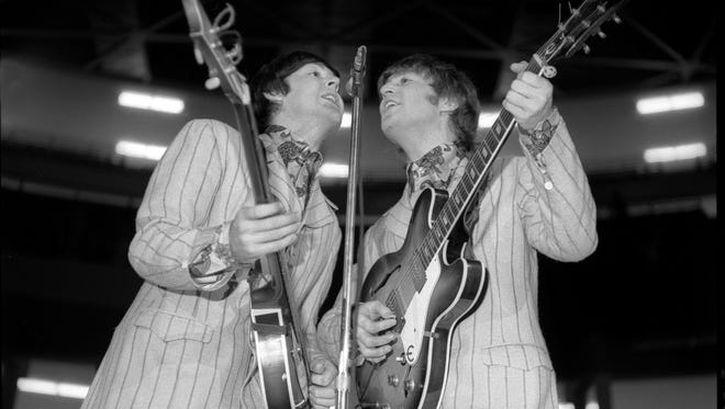 Paul McCartney and John Lennon at Detroit's Olympia Stadium on Aug. 13, 1966