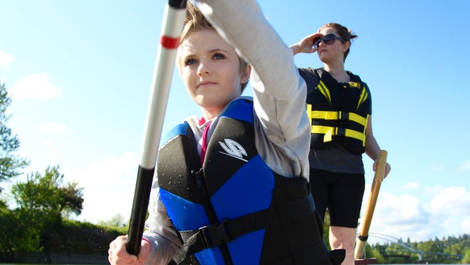 India Watson, 14, and her mother, Cara Watson, prepare for the 250 meters on the Willamette River as part of the World Beat Dragon Boat Races.