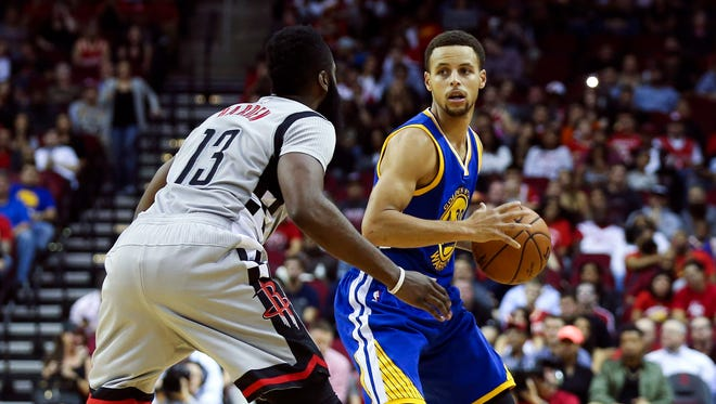 Oct 30, 2015; Houston, TX, USA; Golden State Warriors guard Stephen Curry (30) controls the ball during the first quarter as Houston Rockets guard James Harden (13) defends at Toyota Center. Mandatory Credit: Troy Taormina-USA TODAY Sports
