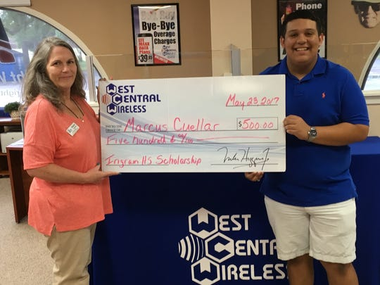Marcus Cuellar of Ingram High School accepts a $500 scholarship, presented by Sharon Cameron with West Central Wireless.