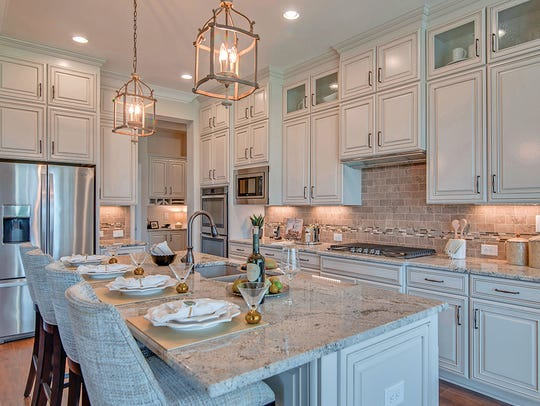 Custom cabinets and a large working island make this