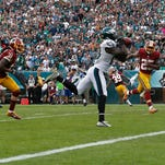 Philadelphia's Jeremy Maclin pulls in a touchdown pass during the second half Sunday.