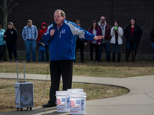 "Deacon Bill Robertson of Christian Life Church leads a prayer outside Henderson County High School on Sunday, Feb. 18, 2018. Community church members gathered at the high school after Sunday services to pray for the safety of students. ""I have worked with the kids for 18 years at church,"" Robertson said, ""They are precious to us."""