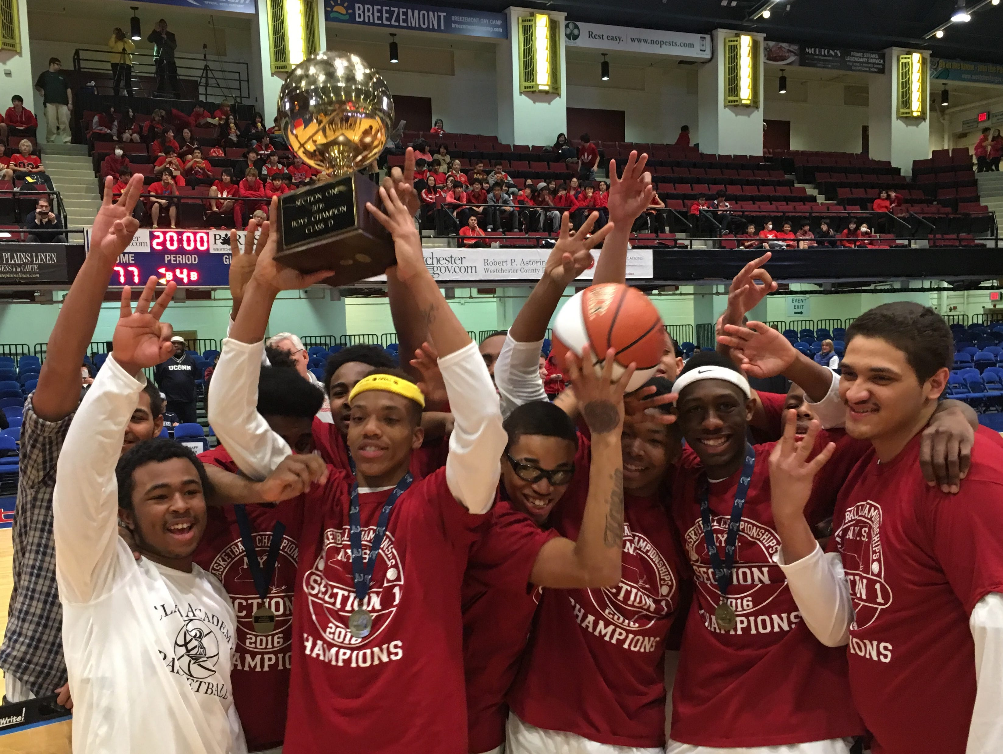 Clark Academy players pose with the gold ball on Monday, Feb. 29, 2016. Clark beat MLK 77-57 to win its third straight Section 1 Class D championship at the Westchester County Center.