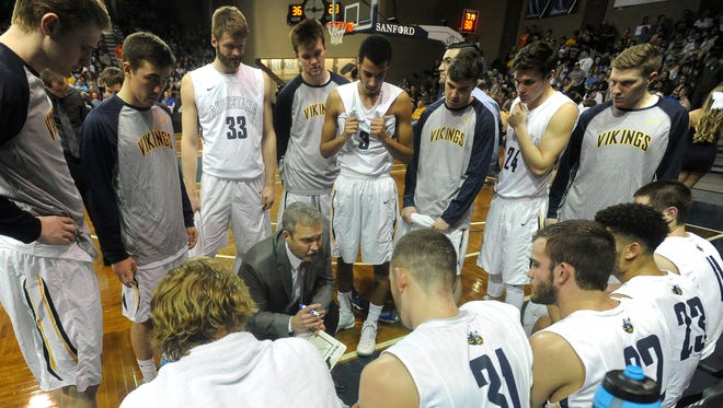 Augustana's head coach Tom Billeter talks with his team during a timeout against Harding during Division II Men's Basketball at the Sanford Pentagon in Sioux Falls, S.D. Saturday, March 12, 2016.